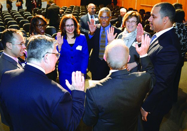 ➥➥Quincy Miller taking an oath during the Eastern Bank annual meeting March 2016.