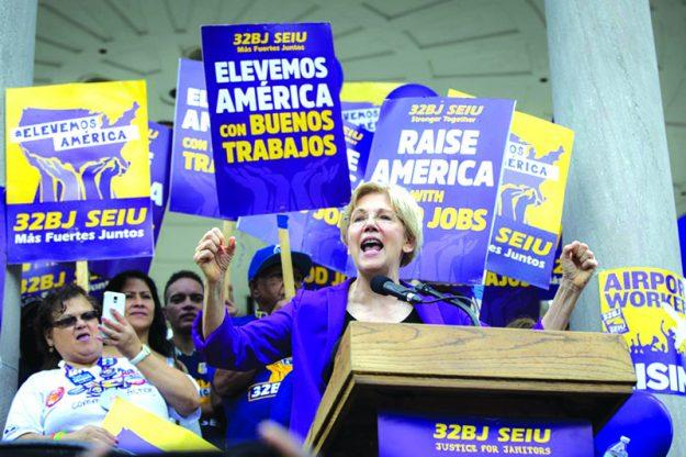"""""""La lucha por salarios justos para nuestras familias es correcto y vamos a ganar nuestra lucha por $15 la hora"""", Senadora Warren."""